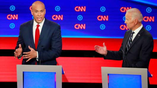 Senator Cory Booker (L) speaks next to former Vice President Joe Biden on the second night of the second 2020 Democratic U.S. presidential debate in Detroit, Michigan, July 31, 2019.