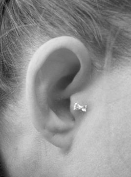 cute bow tragus piercing