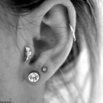 feather tragus piercing