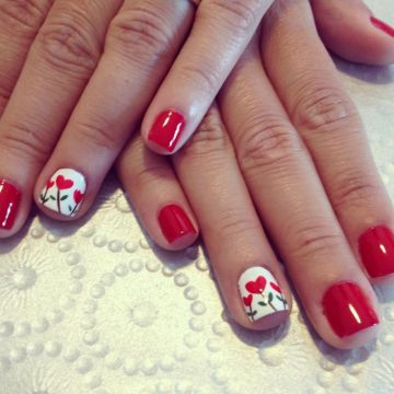 Red nails design heart flowers