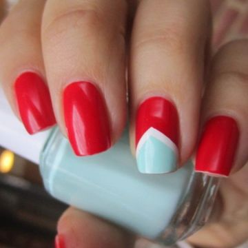 red nail design blue accent