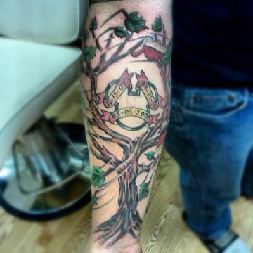 Family tree tattoo on arm