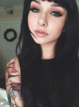 Medusa piercing and tattoo