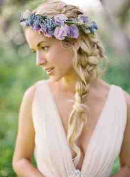 boho bridal hairstyle with side braid and floral head band
