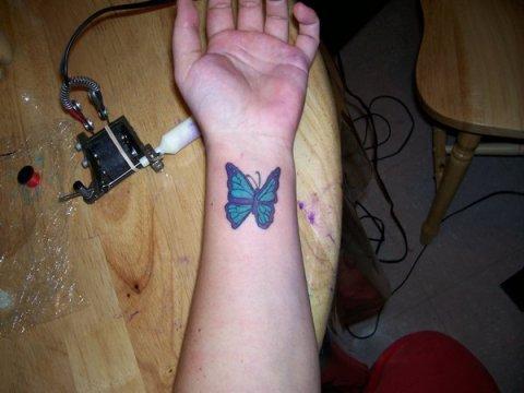 Blue Butterfly Wrist Tattoo