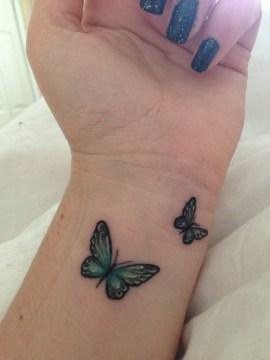 Blue Twin Wrist Tattoo