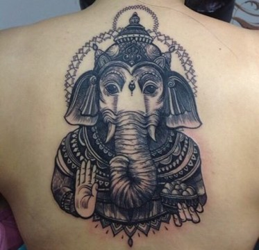 Lord Ganesha on upper back
