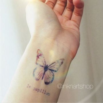 Minimalist Butterfly Tattoo on Wrist