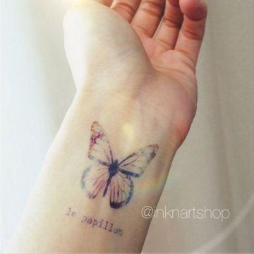 Minimalist Butterfly Tattoo on Wrist