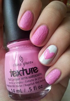 Pink grainy short nails.