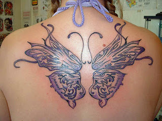 Violet Edge Tribal Butterfly Tattoo