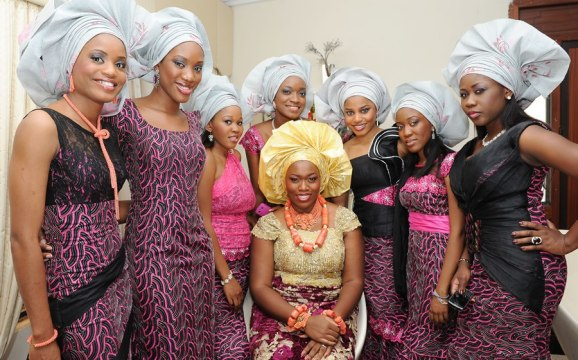 bride with her relatives wearing aso ebi