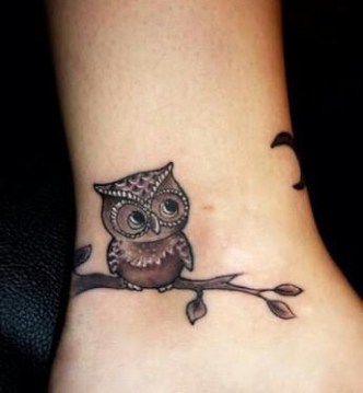 cute little owl tattoo on ankle