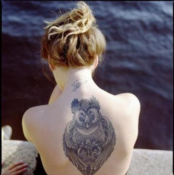 earnest owl eyed tattoo