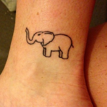 small cute elephant on ankle