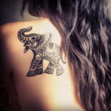 tribal elephant tattoo symbolizes a link to nature