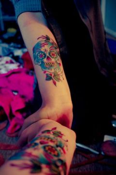 forearm colorful sugar skull tattoo