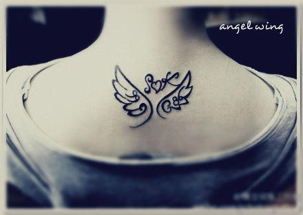 small wings with label tattoo