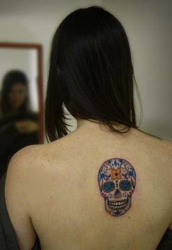 small back sugar skull tattoo