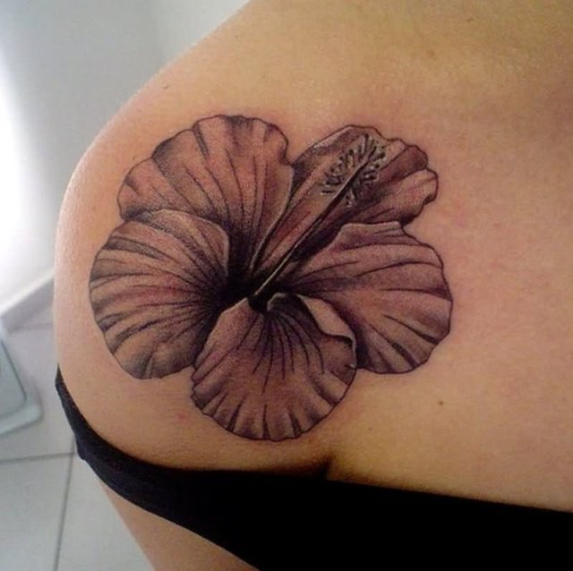 black and white hawaiian flower tattoo