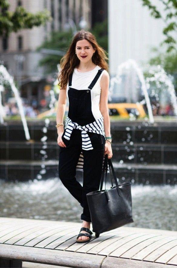 black overalls striped tee around waist