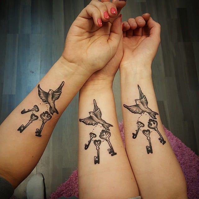 dove keys tattoo inner arm
