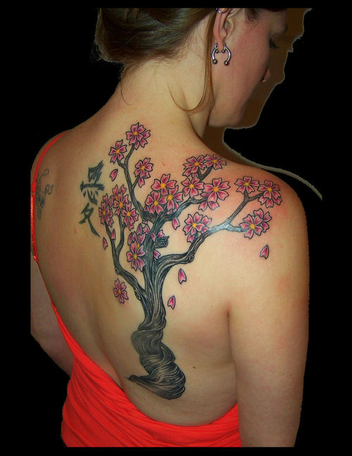 large plumeria tree tattoo on back