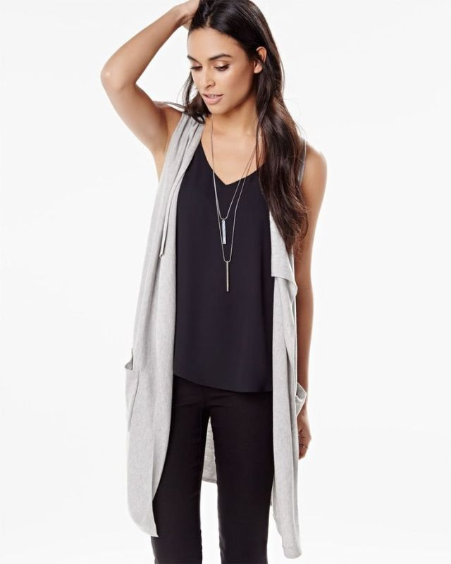 long sleeveless cardigan all black outfit