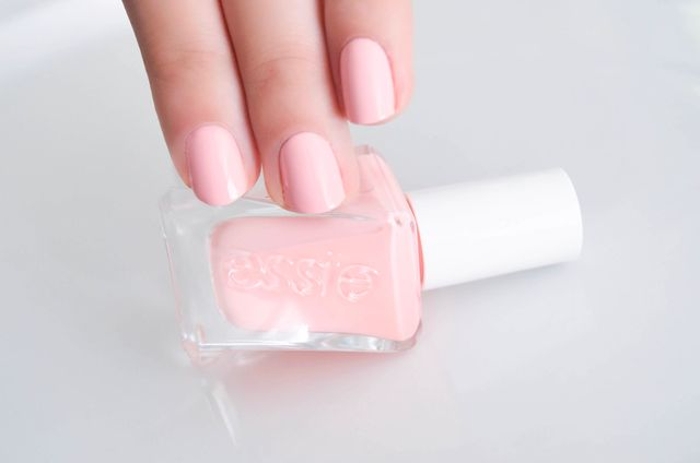 pale pink nail polish for business formal suit