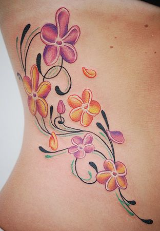 plumeria tattoo on side of body