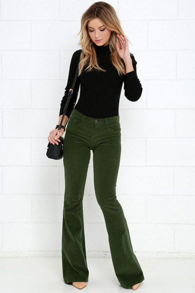black knit sweater green corduroy pants