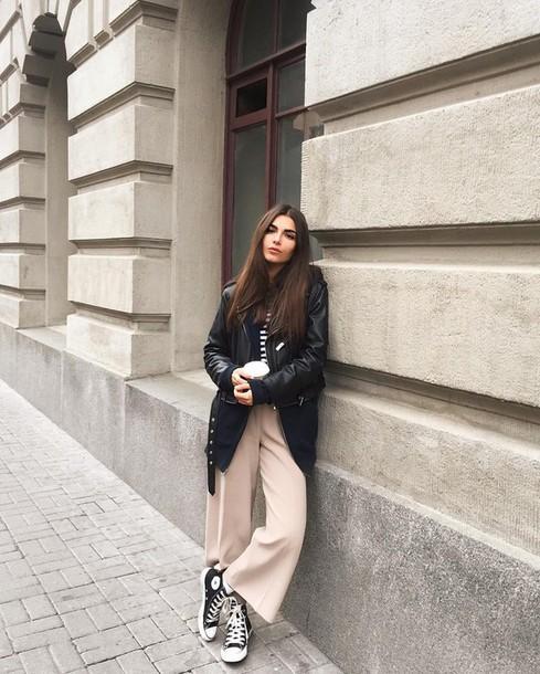 black leather jacket wide leg pants converse