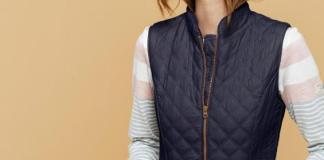 black qulited vest over soft colors