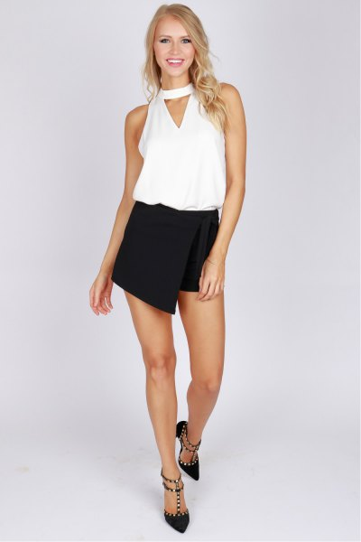 black skort white vest top