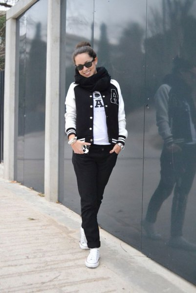baseball jacket black jeans white sneakers