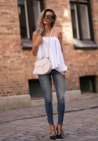black strappy heels off shoulder blouse skinny jeans