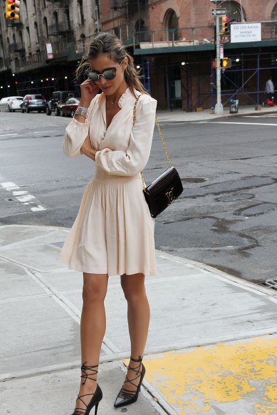 black strappy heels white blouse flare skirt