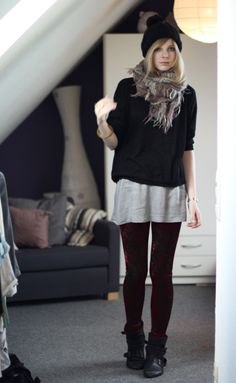 black sweater over grey oversized tee