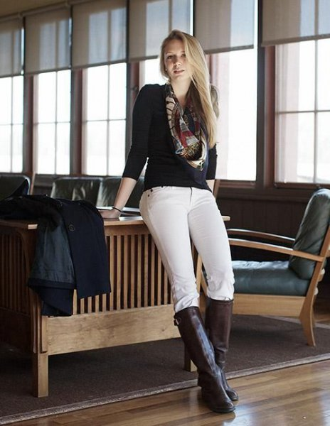 black sweater white riding pants knee high boots