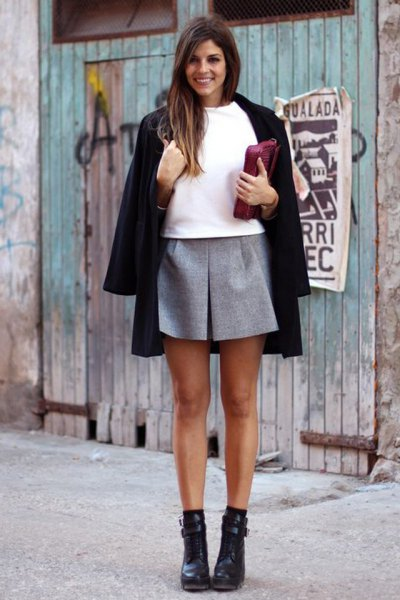 black wool coat white sweatshirt grey mini skirt