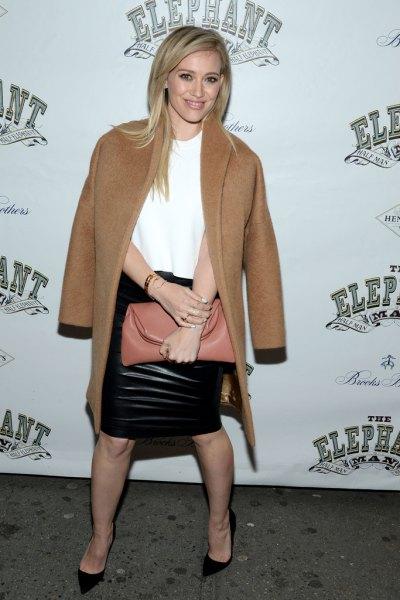 camel wool coat black leather skirt
