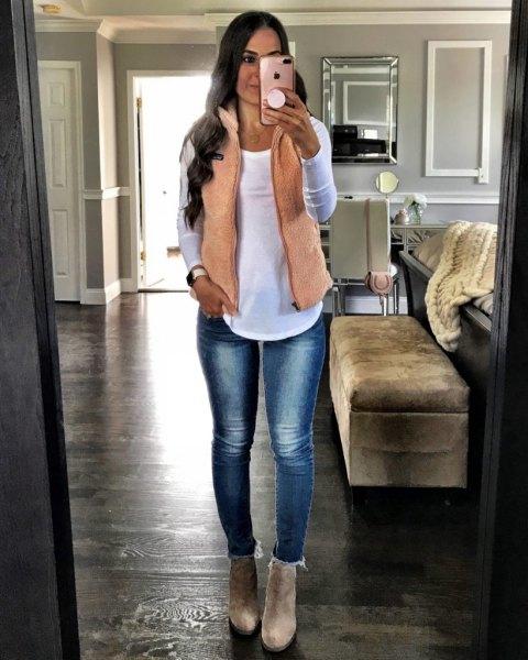 cream vest over white top jeans