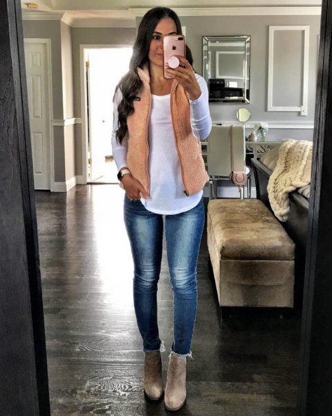 cream vest over white top jeans