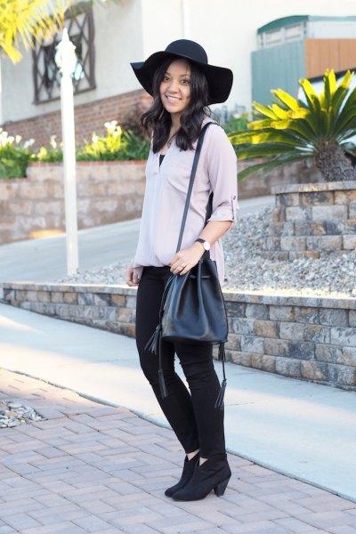 grey blouse black skinny jeans
