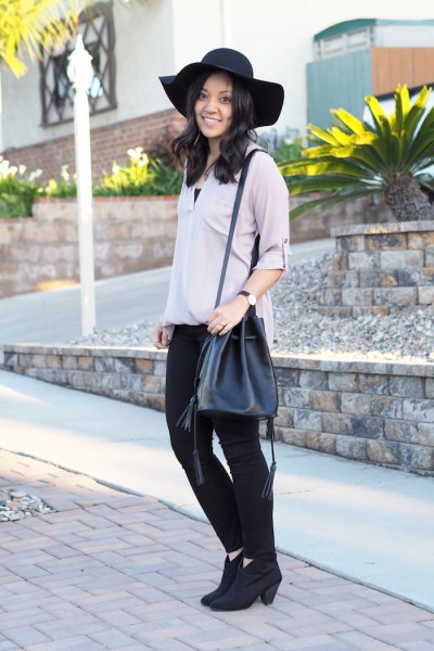 grey blouse black skinny jeans