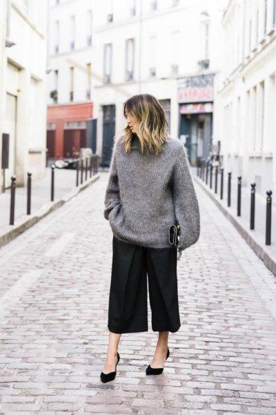 grey oversized knit sweater black culottes.