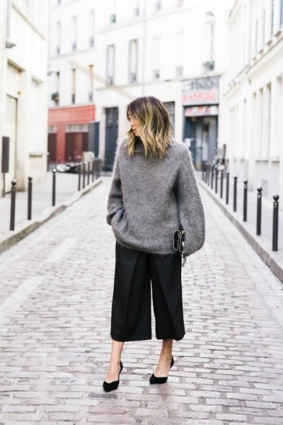 grey oversized knit sweater black culottes.