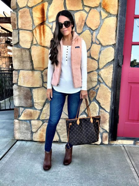 ivory vest over white top ankle boots