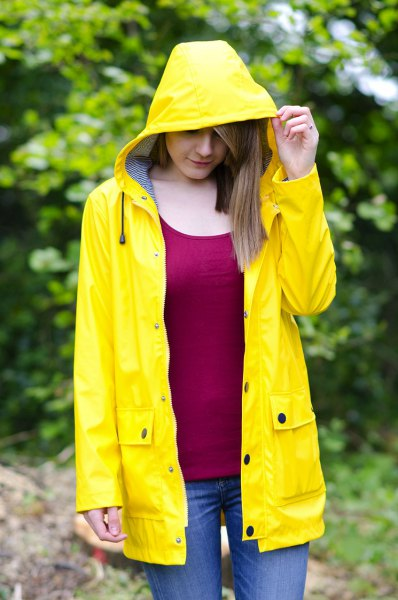 red vest top yellow raincoat jeans