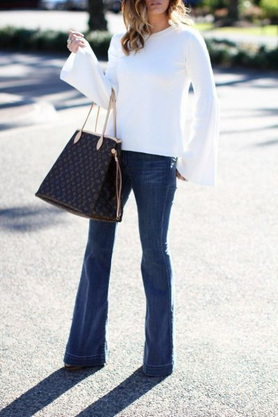 white bell sleeve blouse flare jeans outfit